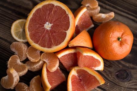 the orange mandarin red on wooden background