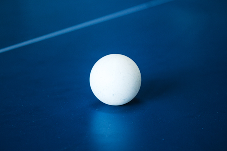 a tennis ball on a tennis table Stock Photo