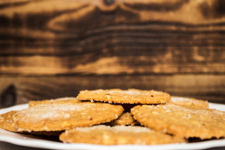 homemade sugar cookie on a plate wooden background