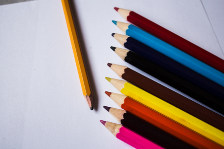 color pencils and pencil folded in a row Stock Photo