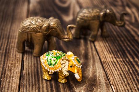 gold elephant with stones handmade iron elephant Stock Photo