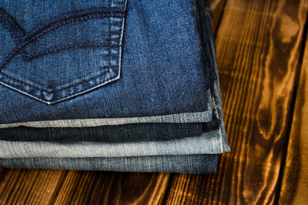 the jeans pile on wooden board store