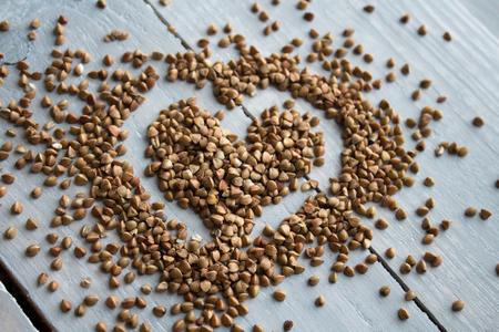 the buckwheat porridge on wooden board heart-shaped