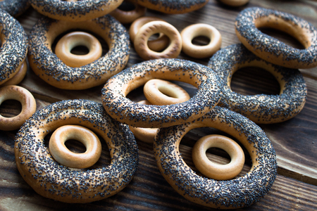a bunch of bagels with poppy seeds