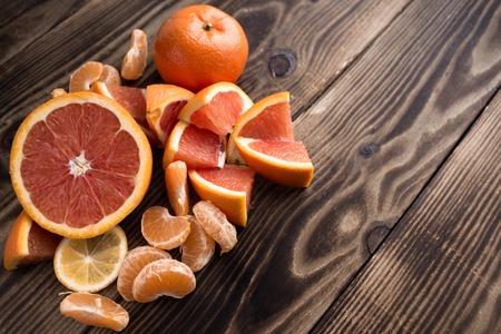 prosper: the orange mandarin red on wooden background