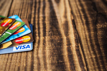 debit and credit cards maestro and visa on wooden background Stock Photo