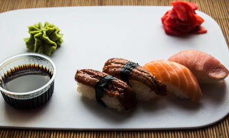 Sushi rolls ginger and wasabi on white background