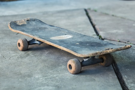 Old blue skate on a gray concrete Stock Photo