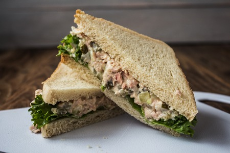 marinated gherkins: the tuna pickles sandwich with salad on white plate