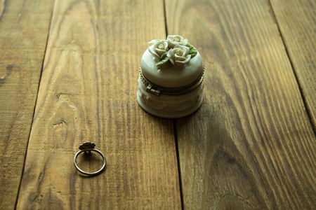 jewelery box and ring on a wooden background