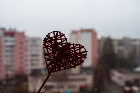 a red heart on a window background