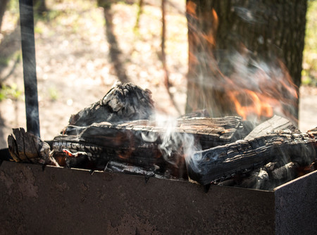 a charcoal fire in the open air