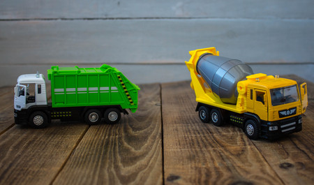 garbage truck and concrete mixer