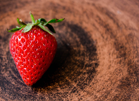 ripe juicy red strawberry on a plate Stock Photo