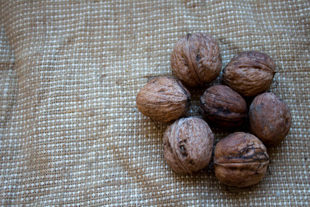 walnuts in the background of burlap 写真素材