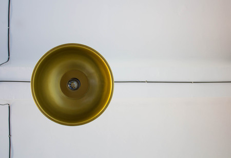 gold chandelier against a white ceiling