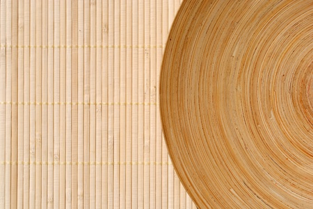 high definition round wooden dish on bamboo background Stock Photo - 10028952