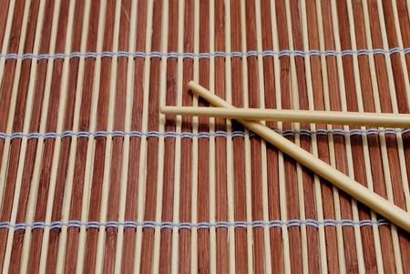japanese chopsticks on bamboo placemat background Stock Photo - 10029275