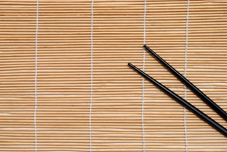 japanese chopsticks on bamboo placemat background Stock Photo - 10029283