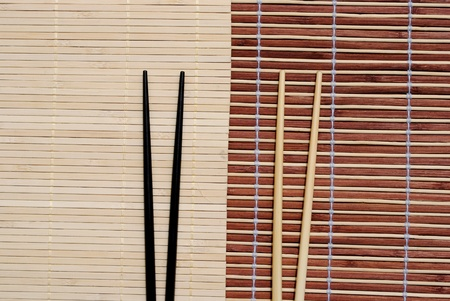 japanese chopsticks on bamboo placemat background Stock Photo - 10029284