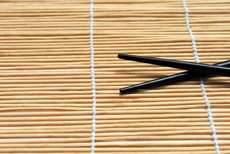 japanese chopsticks on bamboo placemat background Stock Photo - 10029281