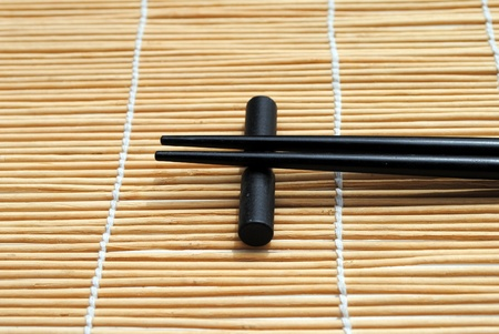 japanese chopsticks on bamboo placemat background  Stock Photo - 10029276