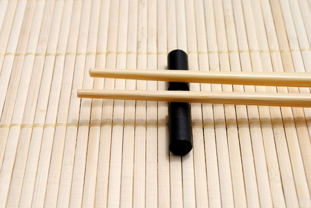 japanese chopsticks on bamboo placemat background Stock Photo - 10029278