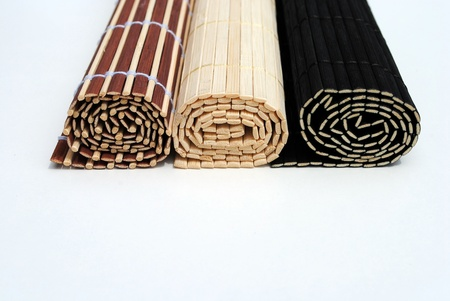 set of three rolled bamboo placemat on white background Stock Photo - 10029279