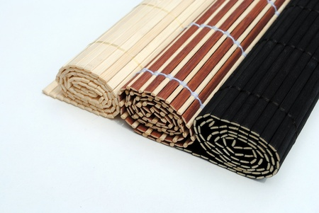 set of three rolled bamboo placemat on white background Stock Photo - 10029280