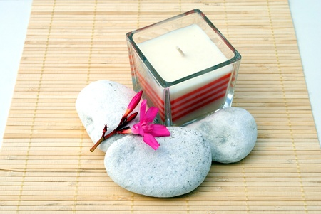 candle with white stones and pink flowers Stock Photo - 10109077