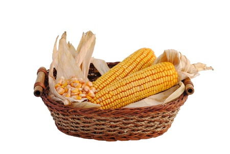 basket of straw and corn cobs Stock Photo