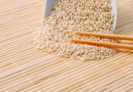 rice with chopsticks on bamboo background photo