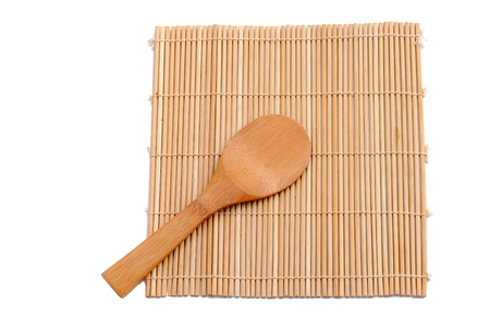 wooden spoon over bamboo placemat photo