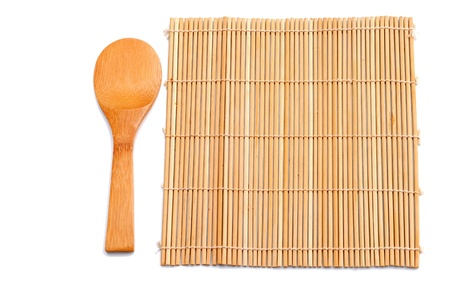 wooden spoon beside bamboo placemat photo