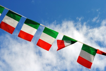 five italian flags wave in the sky