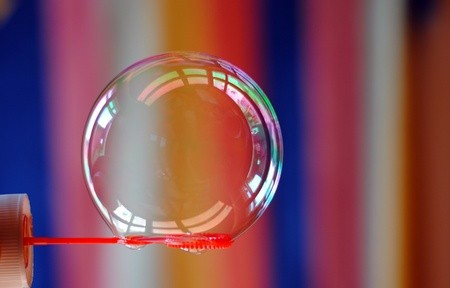 spheres: soap bubble over coloured background