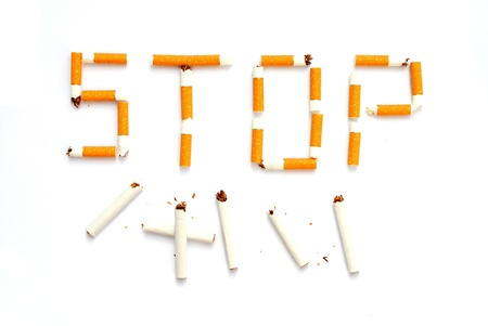 write STOP with cigarette butts, concept of quit smoking Stock Photo