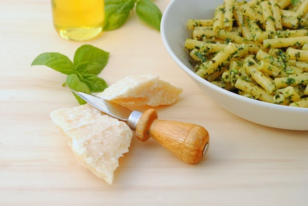 macaroni with typical italian sauce of crushed basil, cheese and oil photo