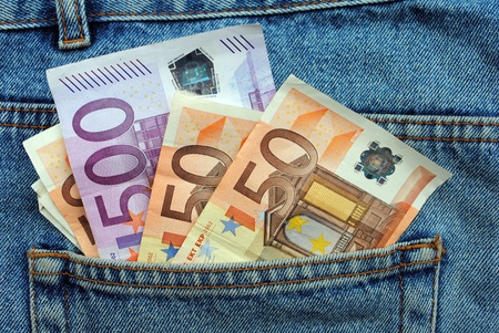 Euro bills in a blue jeans pocket photo
