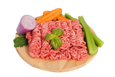 raw ground beef with vegetables on wooden cutting board Stock Photo - 11108437