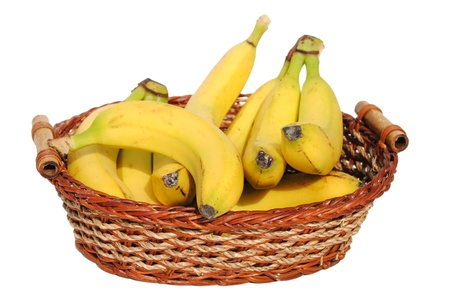 bananas in a straw basket isolated on white background