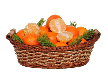 mandarin in a straw basket isolated on white background photo