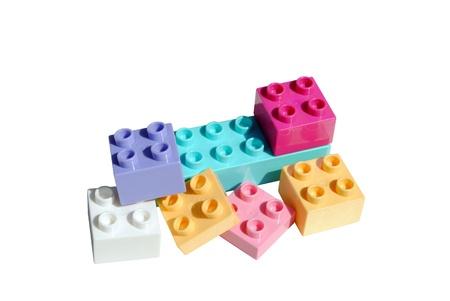 plastic bricks: colored plastic bricks for kids on white background Stock Photo