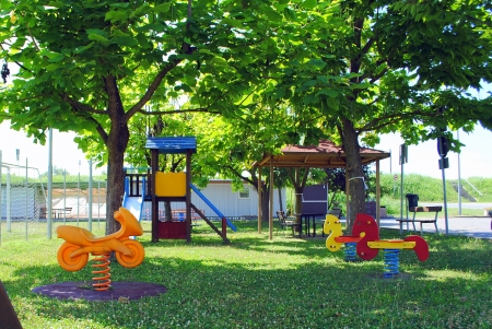 green kids playground with plastic games Stock Photo