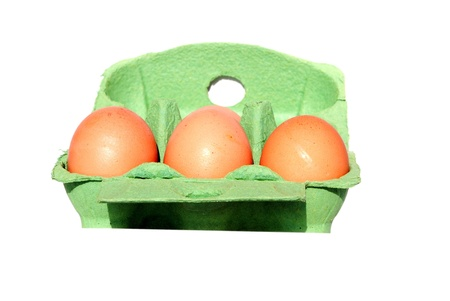 whole eggs in a green box isolated on white Stock Photo
