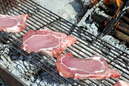 raw pork chops grill on a barbecue Stock Photo