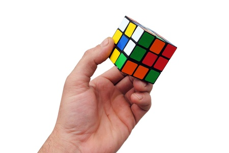 man hand holds a Rubik cube on white background