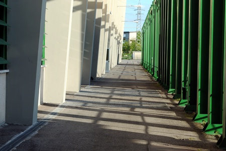 shady: shady path with a wall and green pipes