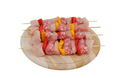 chicken kabobs on a wooden cutting board photo