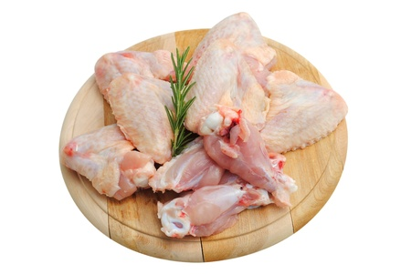 chicken wings on a wooden cutting board isolated on white photo